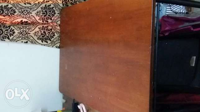 Rarely used 4 seater Dining wooden table for sale at 20