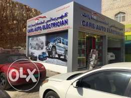 cars auto electrician front of Toyota in al Maha Petrol station Gala