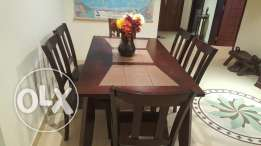 Six seater dining table pure wood From Home centre.