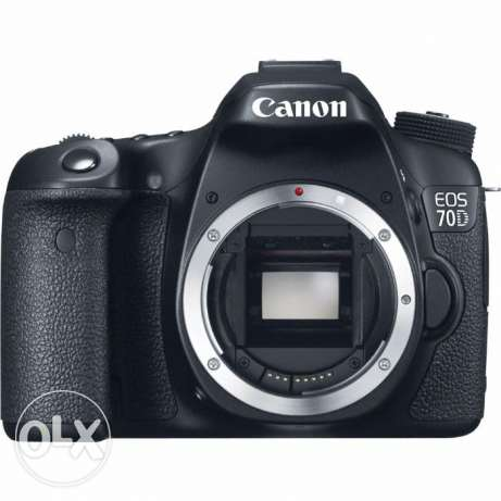 Canon 70 D + Canon lens 50mm 1.8 + Protection cover + Battery grip