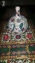 A ne and very pretty decorative painted vase with flowers'design