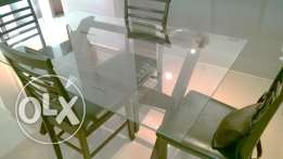 Glass Topped Table and four chairs OMR 80