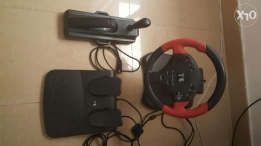 A set of wired playstation accessories for playing car racing.