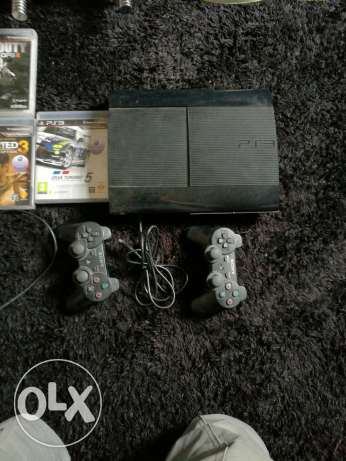 PS3 super slim with 4 games and 2 controllers مسقط -  1
