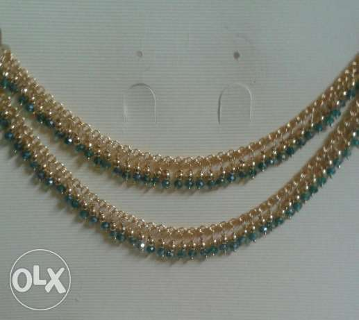 Anklet with green crystals and gold plated beads. بدبد -  1