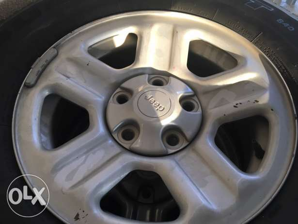 Jeep Wrangler sport rims with tires