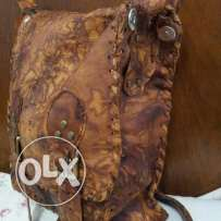 Natural leather bag hand made .