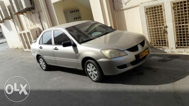 Mitsubishi Lancer is very clean, everything works very well بركاء -  7