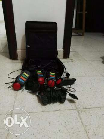 Sony PS2 Playstation2, console, steering, buzz controllers with games مطرح -  4