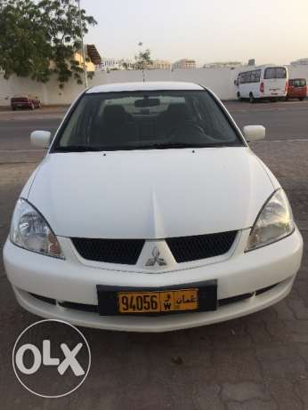 2011 lancer 1.6cc full automatic new insurance ,location Al Azaiba