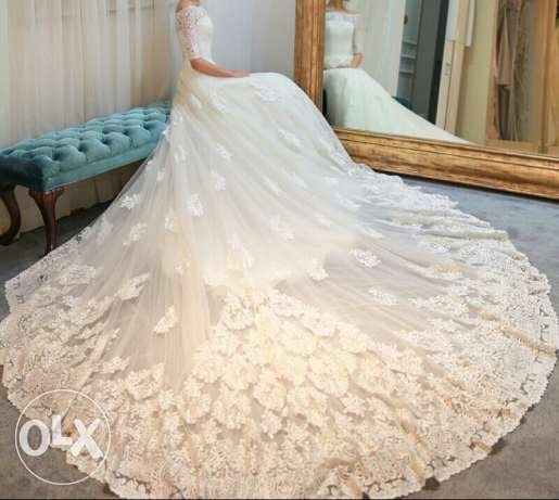 NEW WEDDING DRESS for sale/ rent صحار -  1