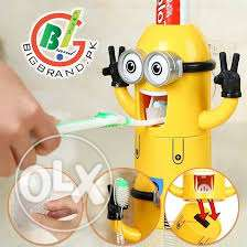 kids tooth paste dispenser with brush holder