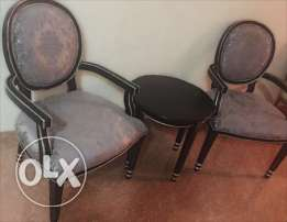 Two arm chairs and a table for sale