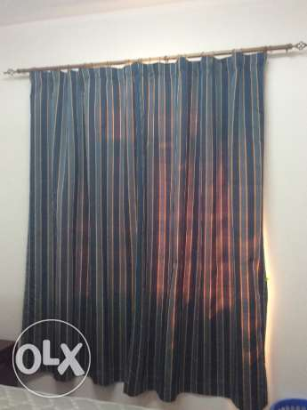 Window curtain with adjustable rod