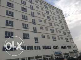 shop for rent in a building near al amin mosque.