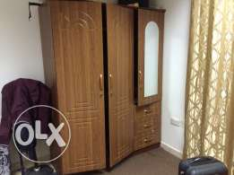 spacious three door cupboard with mirror