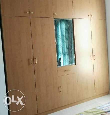Cot with mattress, wooden cupboard