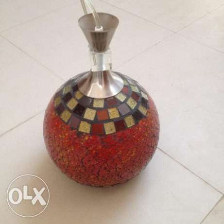 Ceiling lamp bought in Dubai. Made of red and colored mosaic glasses.