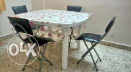 Table with 4 foldable chairs & designer table cover