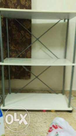 Plastic Table with three racks and wooden table with rolling wheels مسقط -  1