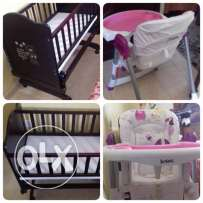 highchair and baby bed