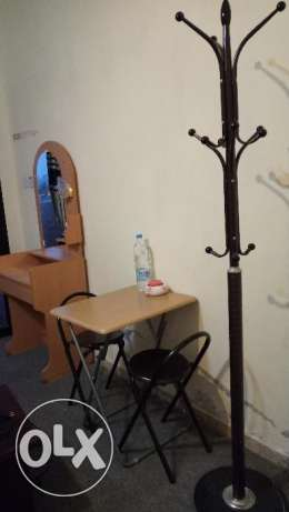 Dresser, folding chairs and tables, and coat hanger.