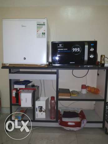 Small fridge, microwave oven, computer table