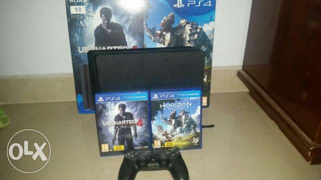 ps 4 slim 1 tb with 2 games and 1 controller