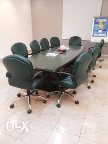 Conference room table with 10 luxury chairs