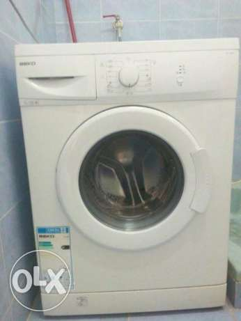 Automatic washing machine and wooden cupboard