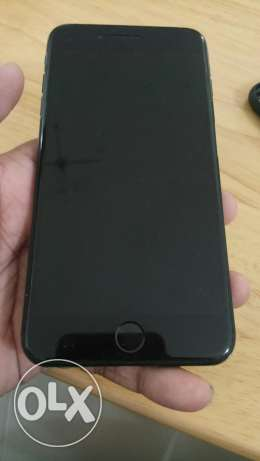 Apple iPhone 7 plus 128 gb jet black with clear coat.