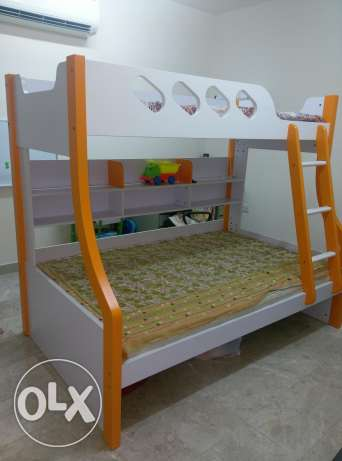 Kids bunk bed with mattress 1yr old in very good condition