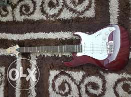 Electric guitar + amplifier