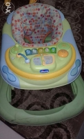 Green baby walker Chicco brand