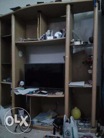 TV stand with shelves; expat leaving Oman for good; negotiable; muscat مسقط -  1