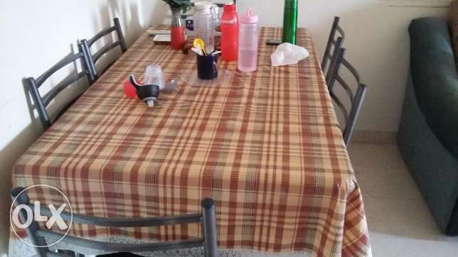 Six Seater Dining Table neatly maintained for urgent sale