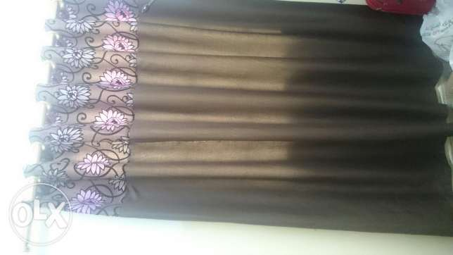 Two curtains with golden rod