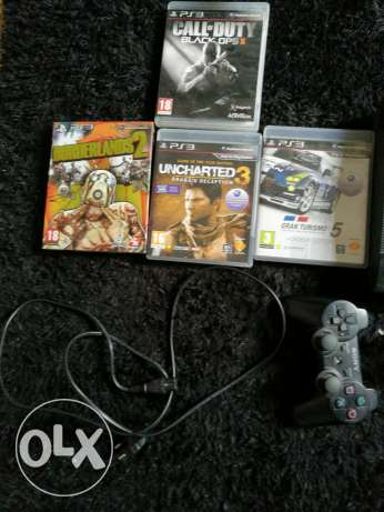 PS3 super slim with 4 games and 2 controllers مسقط -  2