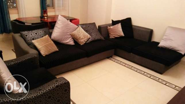 Cavalini- black Sofa for sale with tea table and side table