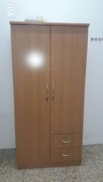 Wardrobe, cot with matress, table with chair & curtain withrails