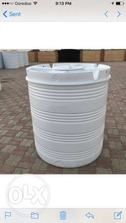 water or oil storage drums in black and white 100 Gallon