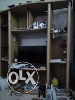 TV stand with shelves; expat leaving Oman for good; negotiable; muscat