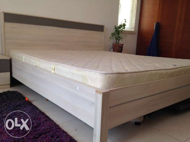 King bed with mattress and side tables