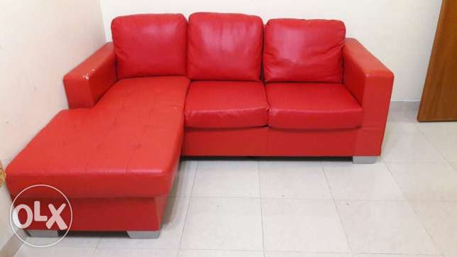 Elegant red sofa for sale