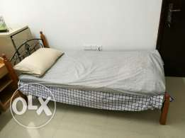 bed with matress and pillow