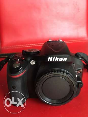 Nikon D5200 body with Tamtrac camera bag