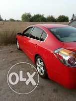 Nissan altima red colour v6 very good condition full automatic