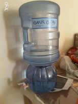 Oasis water cans 2 nos. And a dispenser