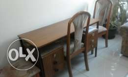 wooden table with 3 chairs and 6 draws