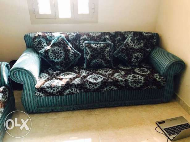 7 seater sofa set and a dining table with 4 chairs